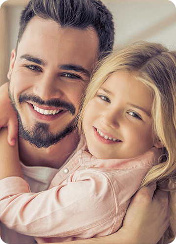 a father and daughter smiling together