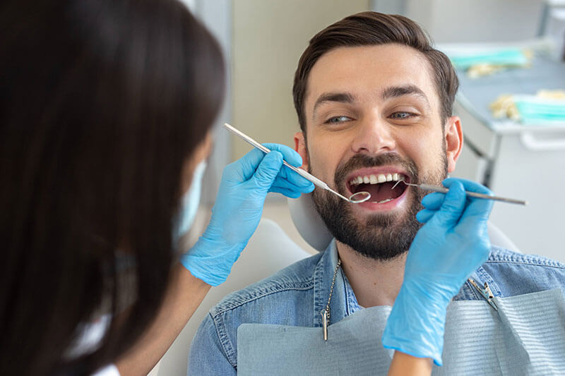 a young man receiving a dental exam