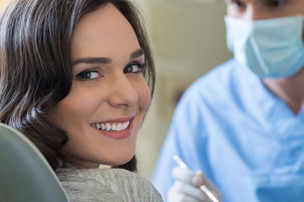 young woman smiling at her dental appointment