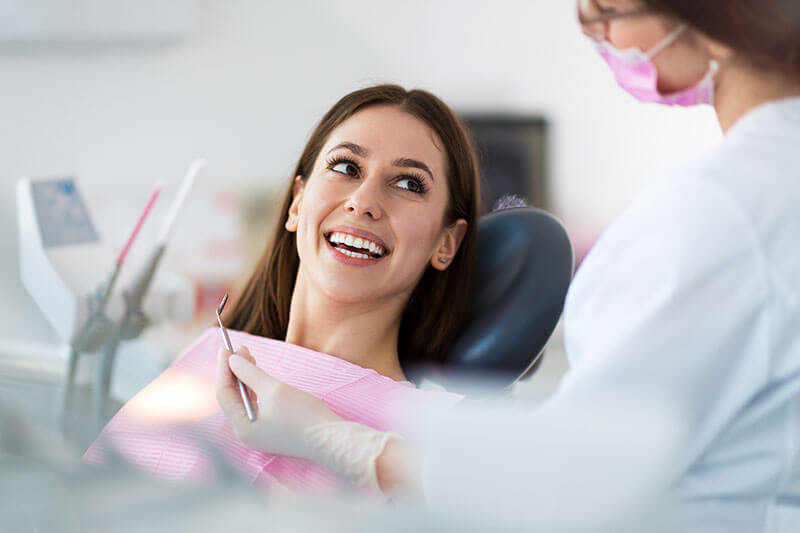 young woman in the dental chair for a dental checkup